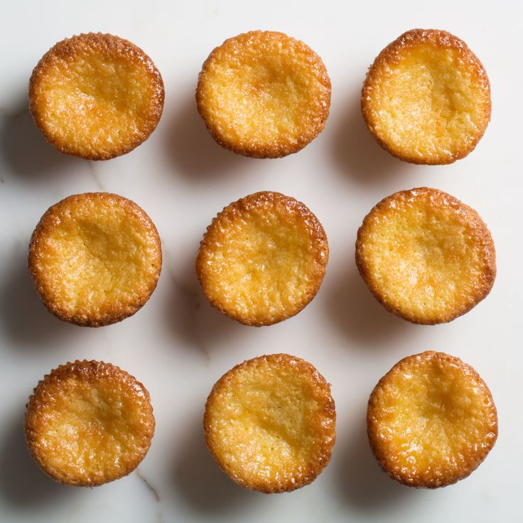 Beating the butter and sugar properly (read thoroughly) gives these mini cakes lift, but they will still be moist and marzipan-y in the center.