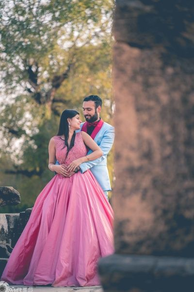 Pre Wedding Shoot - Bride in a Pink Flare Gown and Groom in a Blue Suit with Pink Detailing   WedMeGood #wedmegood #indianbride #indianwedding #preweddingshoot #preweddingideas #prewedding #gown #pink #blue #suit #candid