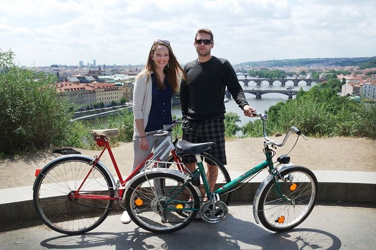 US couple enjoying the view on the Vlatva with our bikes