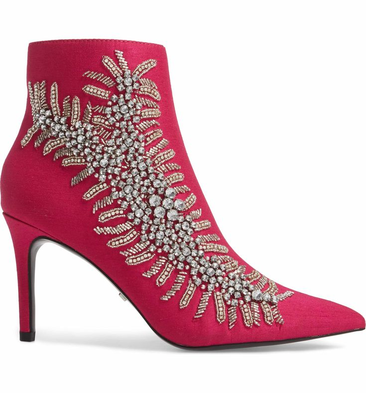 Shimmering bead and crystal embellishments add vintage rock-star glamour to a lofty pointy-toe bootie.