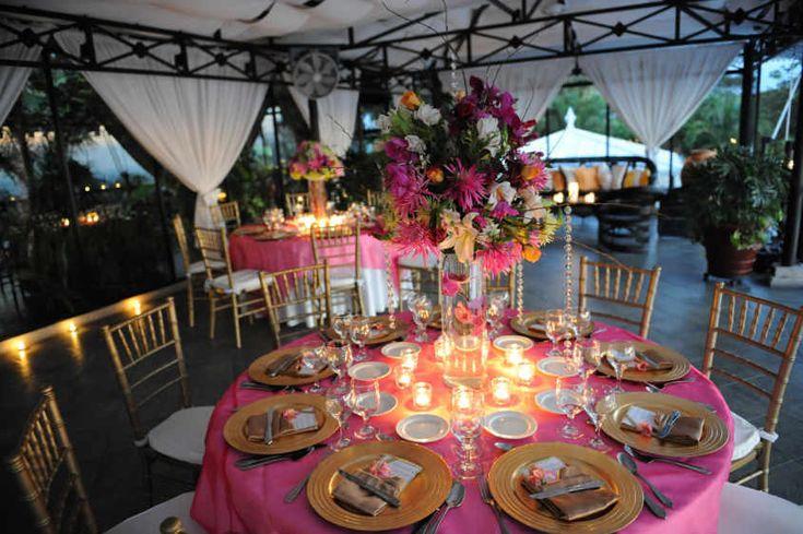 Weddings Costa Rica - gold and fuschia wedding reception at night