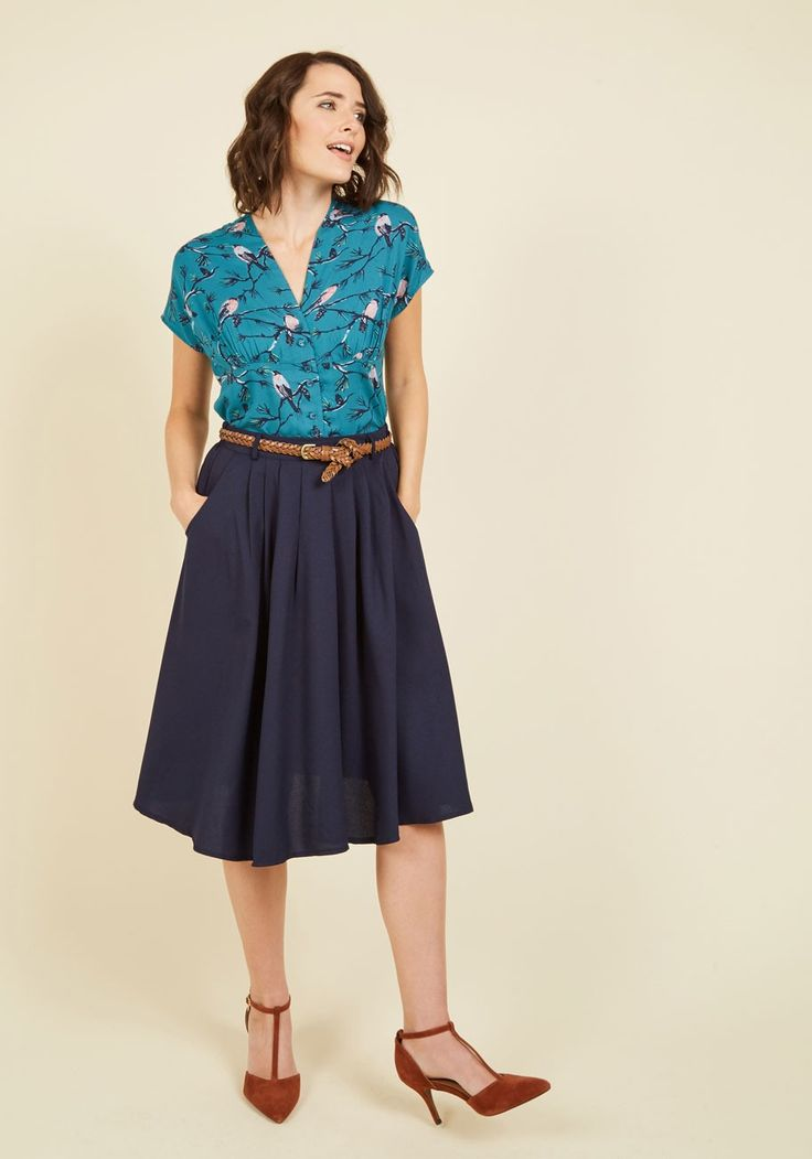 Breathtaking Tiger Lilies Midi Skirt in Navy | Mod Retro Vintage Skirts | ModCloth.com  This morning, a bundle of bright flowers was waiting at your door. You excitedly scooped them up, deciding to wear this navy midi skirt to match their beauty! You clasp the braided faux-leather belt through the loops that sit along the fitted-back waistband, and happily sling a hand in the pocket of this pleated-waist skirt.