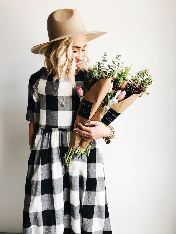 Flowers and our buffalo plaid dress with the photogenic @gparrish