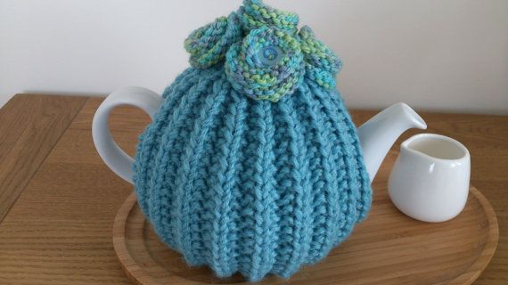Turquoise hand knitted tea cosy with knitted button by DottyKnits