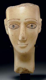 A SOUTH ARABIAN ALABASTER HEAD OF A MAN CIRCA 1ST CENTURY B.C.-1ST CENTURY A.D.