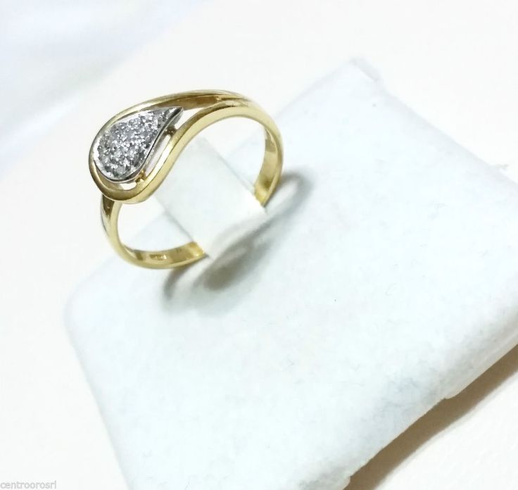 Anello in oro 18 kt (750/000) con Diamantini
