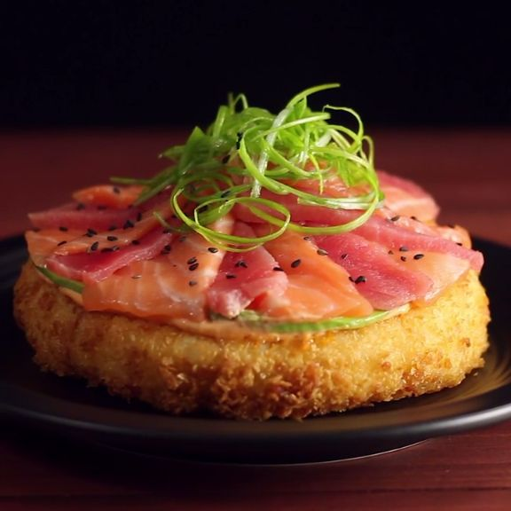 A crispy rice patty topped with avocado, fresh tuna and salmon is fusion food at its finest.