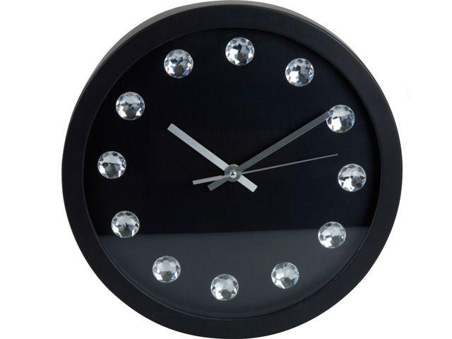 Okrągły, stylowy zegar ścienny z dekoracyjnymi kryształkami zamiast cyfr. Wyposażony we wskazówki do odmierzania godzin i minut oraz sekundnik. Z pewnością stanie się atrakcyjną ozdobą każdego wnętrza. Mechanizm tykający. Ø 30 cm