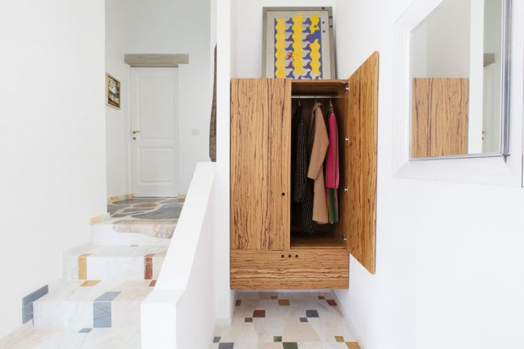 eclectic closet design with floating base and wooden material of Small Closet Organizers: Small Storage Solution for Apartment-Sized Houses