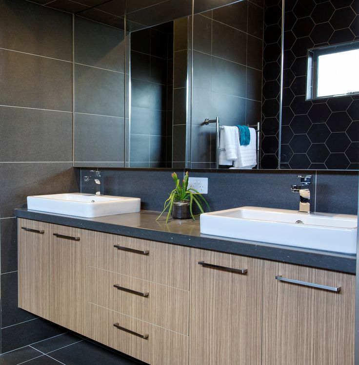 Ensuite Vanity by Bourke's Kitchens Benchtop - CaesarStone Piatra Grey Joinery - Zebrano (Natural Finish) by Laminex Handles - M1295.160 in Brushed Nickel by Furnware Dorset
