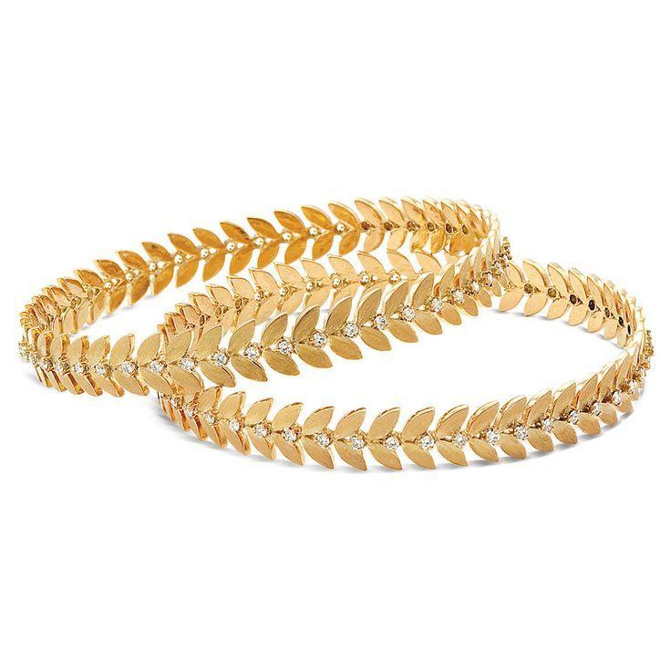 Leaf design gold bangles studded with diamonds from Rasvihar