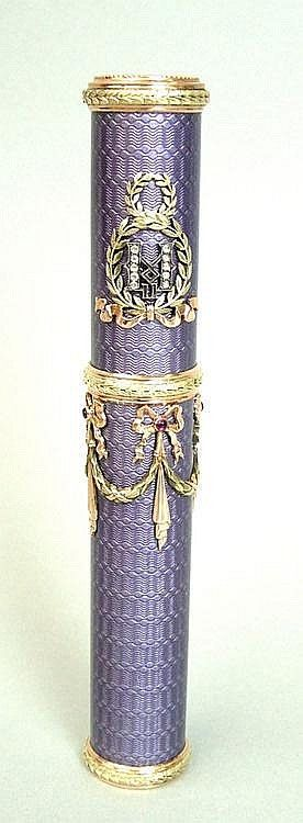 A bi-colour gold, lilac enamel, ruby and diamond set cigar tube & cover in the style of Faberge. The body with engine turned ground and an all over lilac enamel decoration, with bi-colour gold, ribbon, swag and laurel wreath mounts. With a fitted wooden case. 14.75cm long.