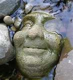 hypertufa face - sculpt reverse in sand try using an old haloween mask for a mold
