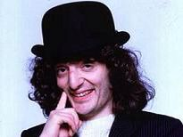 Jerry Sadowitz - saw him getting on a number 38 bus at the junction of grays inn road and theobalds road, in london.  cdx
