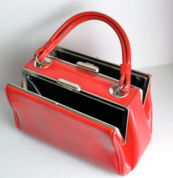 This red beauty is courtesy of DOVER and was Made in the USA. Its unique design is a show stopper. Each side opens to a clean black vinyl interior. One side is stamped Dover, Made in USA. The hardware is gold tone and the latches work well. The purse measures about 11 1/2 long and 7 tall and 6 deep.    Overall in fabulous condition. There are some scuffs and marks here and there on the outside. The worst one is on the bottom, that is visible in the pic #4. The hardware has some wear, there…