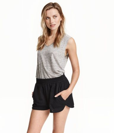 Check this out! Short shorts in eyelet-knit jersey with an elasticized waistband and side pockets. Unlined. - Visit hm.com to see more.