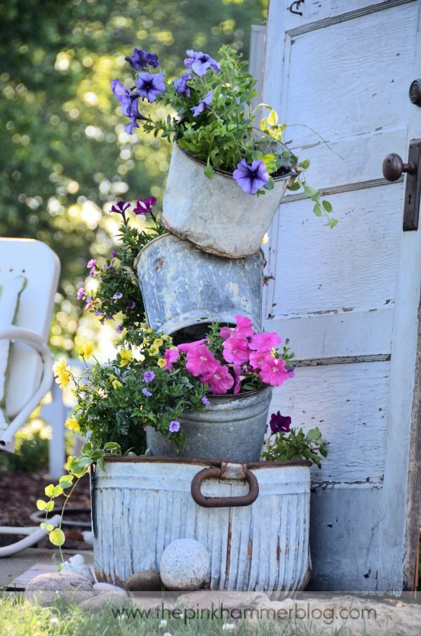 rustic bucket garden tower: Flowers Gardens, Gardens Ideas, Seedlings Can, Flowers Pots, Gardens Planters, Tipsy Pots, Gardens Features, Clay Pots, Rustic Gardens Decor