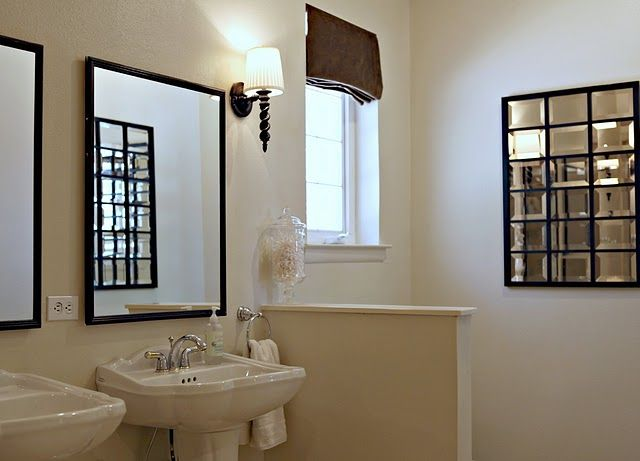 Master bathroom with tan walls paint color black mirrors for Master bathroom paint colors