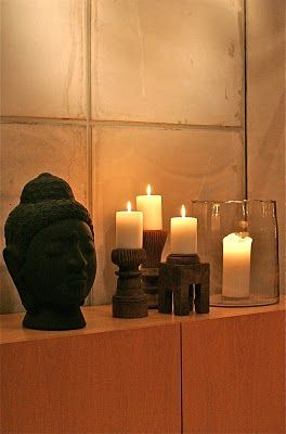 Dark statues with ample candle light for meditation space