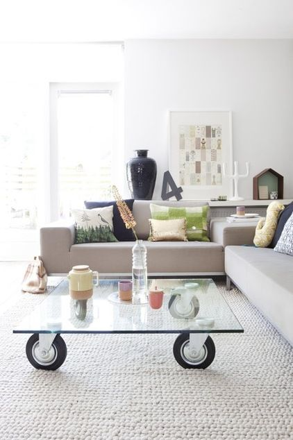 A piece of glass can be transformed into a simple coffee table — just add some wheels as a base for nifty mobility.