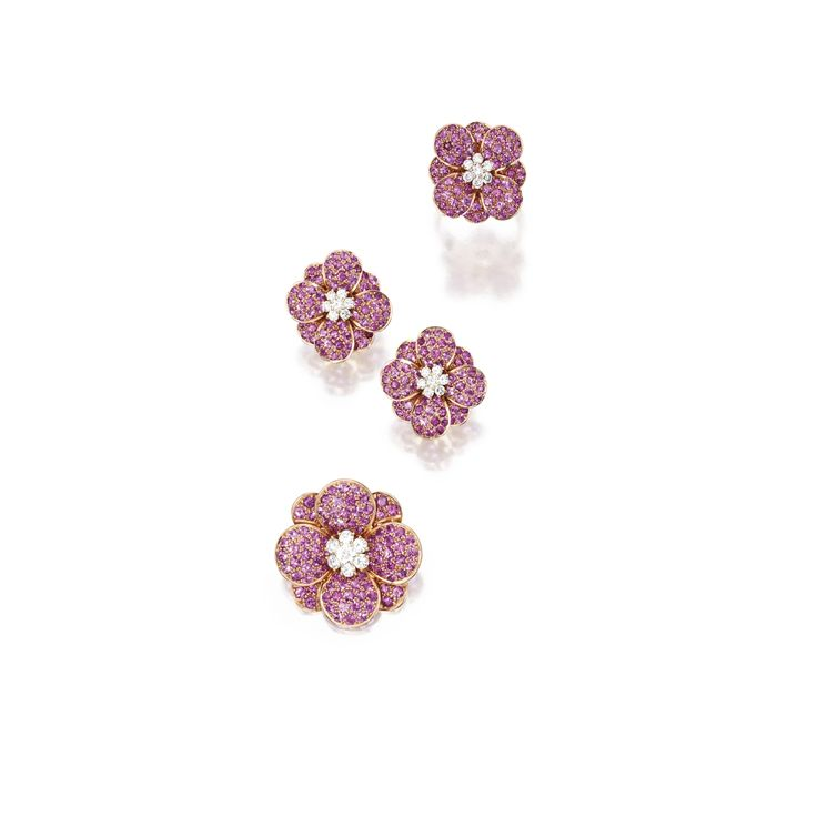 Suite of 18 Karat Gold, Pink Sapphire and Diamond Jewelry, Van Cleef & Arpels Comprising a brooch, ring and earrings of floral design set with pink sapphires centered by round diamond clusters weighing a total of approximately 1.80 carats,