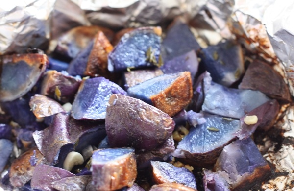 Roasted blue potatoes. A little bland, but improved with salt. A good base to work with !