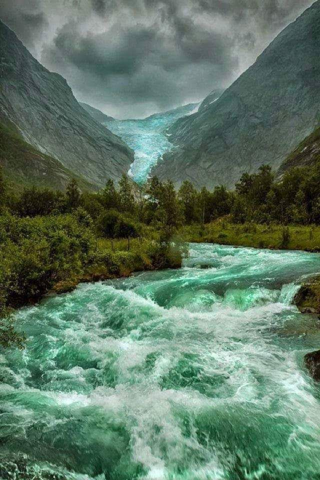 The sheer beauty of the rushing waters of the  Briksdalsbreen Glacier in Norway, rugged, yet so beautiful!