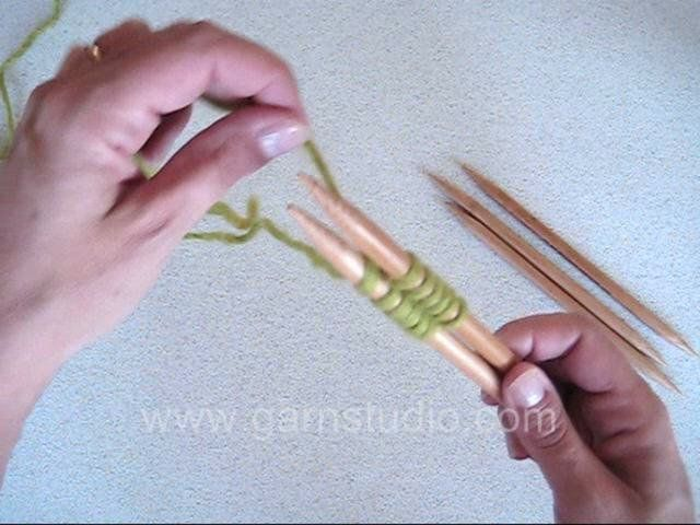 DROPS Knitting Tutorial: How to do the magic cast on for toe up sock, mittens etc. Cast on sts on two double pointed needles and work one ne...