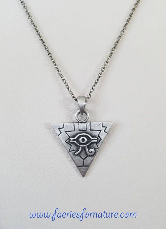 This beautiful Egyptian piece was inspired by Illuminati, the anime Yu-Gi-Oh and many stories from mythology. Great piece for any cosplay, costume, or renaissance play. Perfect for any crystal lover as well. Hypo allergenic. Made for those with metal allergies. Safe for giving when