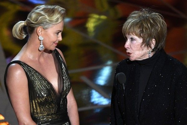 Charlize Theron Photos Photos - South African-US actress Charlize Theron (L) and US actress Shirley MacLaine present the Best Foreign Language Film award at the 89th Oscars on February 26, 2017 in Hollywood, California. / AFP / Mark RALSTON - 89th Annual Academy Awards - Show