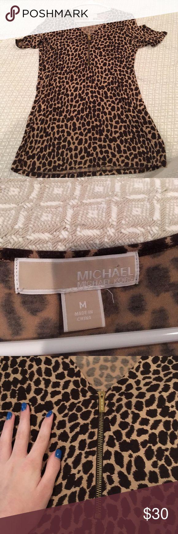 Micheal Kors cheetah print short sleeve shirt Michael Kors cheetah print shirt. LIKE BRAND NEW! Worn once! Very soft material! Michael Kors Tops Blouses