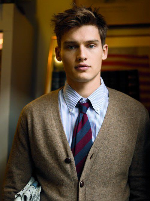 Light blue striped oxford cloth button-down shirt, brown wool cardigan, regimental tie. Ivy style: check