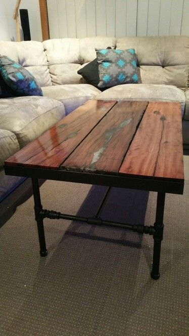 Hand made recycled red gum sleeper coffee table. Complete with glow in the dark epoxy filled grooves.