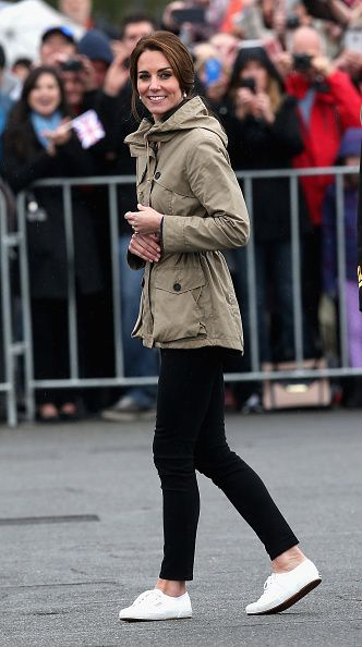 Catherine, Duchess of Cambridge in black skinny trousers, an olive green parka, and Supergas.