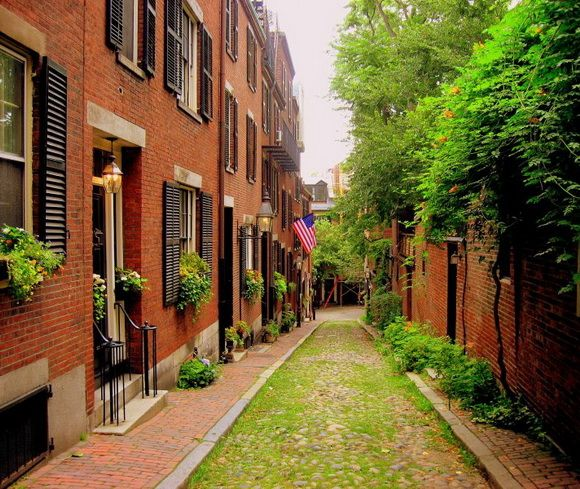 Boston. Acorn Street, USA: It is a narrow lane paved with cobblestones that was home to coachmen employed by families in Mt. Vernon and Chestnut Street mansions.