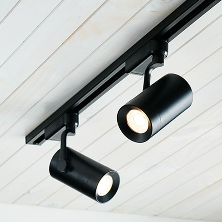 The Beacon Lighting LEDlux Action 1 light 600 lumen dimmable black cylinder track spot only in warm white. Track sold separately.