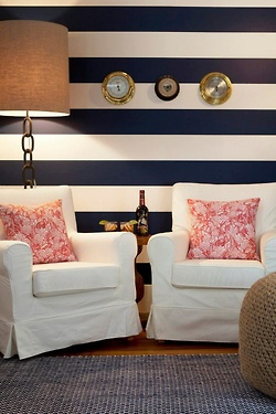 navy and white striped wall, white slip covered furniture. Love!