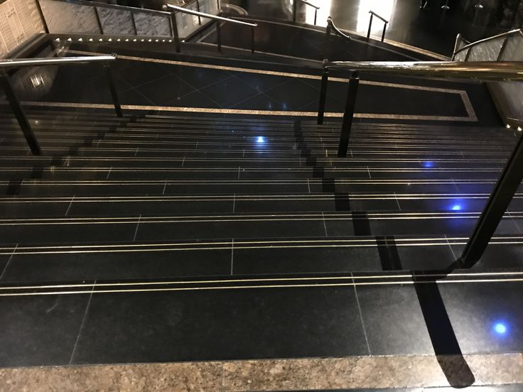 Photo 7:  Marble staircase in crown. This beautiful staircase is the perfect entrance to make a statement. The polished finish allows the light from the ceiling to reflect and create an almost mirror effect.