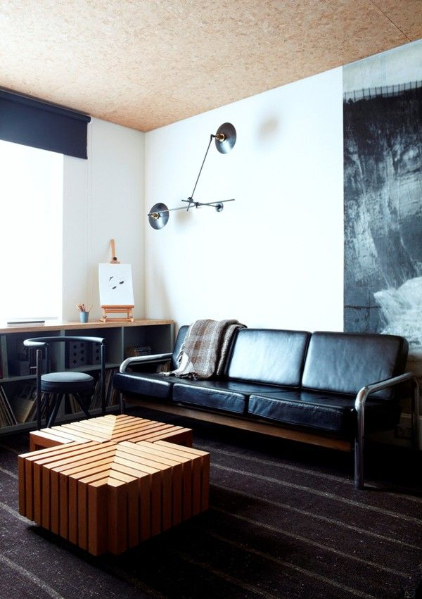 Modern leather sofa, spacious room, wooden tables