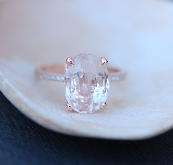 A bit over budget, but a gal can dream. Blake Lively ring Peach Sapphire Engagement Ring by EidelPrecious