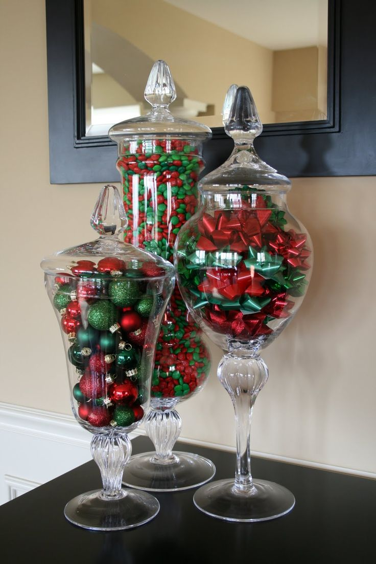 Apothecary jars filled with red and green Christmas ornaments.....or fill them with CANDY!