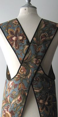 Cross-back apron. Pattern available here: http://www.outonthetownbibs.com/apron.html