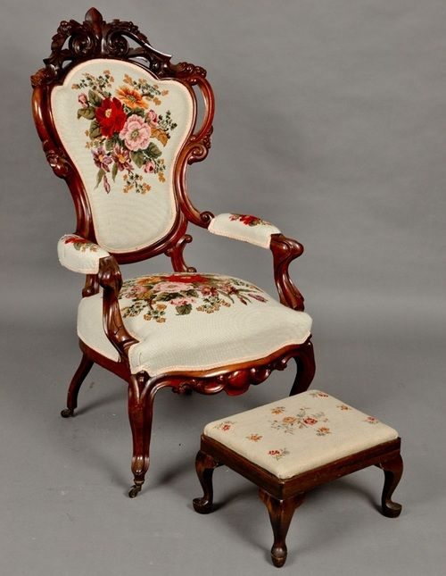 Heavily carved Rococo Revival needlepoint armchair with stool, mid 19th century.