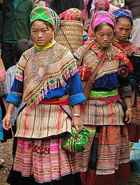 Hmong Women in Traditional Dress. The Hmong (pronounced [m̥ɔ̃ŋ]), are an Asian ethnic group from the mountainous regions of China, Vietnam, Laos, and Thailand.