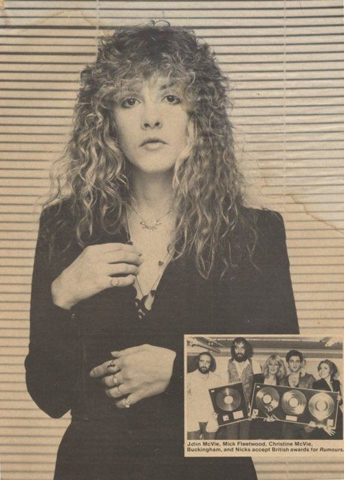 Stevie ~  with awesome hair stands in front of 'those' venetian blinds that were in Herbert W. Worthington 111's studio ~ inset is a newspaper article of all the Fleetwood Mac members  receiving awards for their 1977 'Rumours' album  ~  https://en.wikipedia.org/wiki/Rumours_(album)