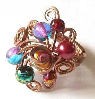 Fantastic, fun, colourful cocktail ring made out of copper wire with multi-coloured glass beads.