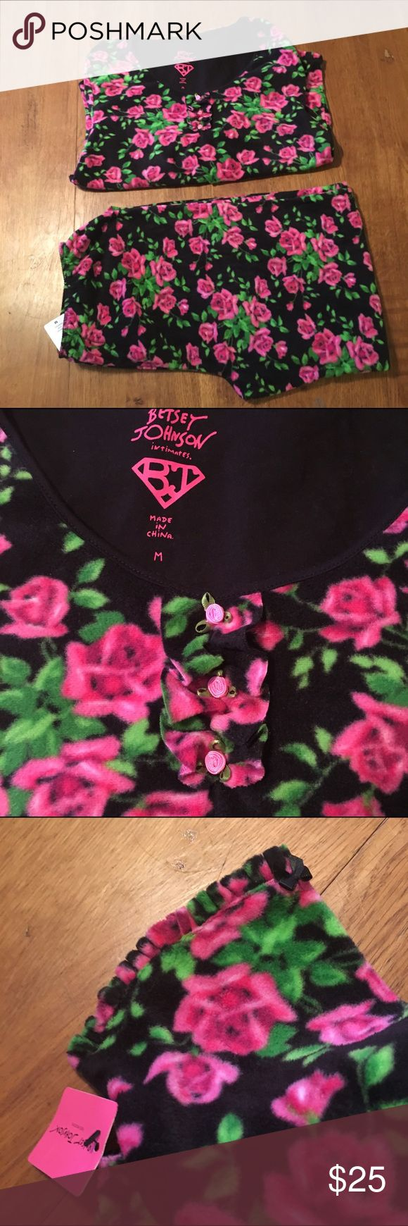 "Betsey Johnson Fleece Pajamas Black fleece with pink, fuschia, and green floral print pj's by Betsey Johnson. So soft and warm! Perfect for lounging on cold winter mornings! Size M. Shirt Bust: 18"" Waist: 18"" Hip: 19"" Length: 25 1/2""  Pants Waist:14"" Hips: 21 1/2"" Inseam: 28"" Betsey Johnson Intimates & Sleepwear Pajamas"