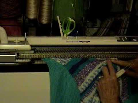 First of two parts about knitting the neckband for the V-neck child's raglan sweater. Suitable project for a beginner machine knitter, and no ribber required...