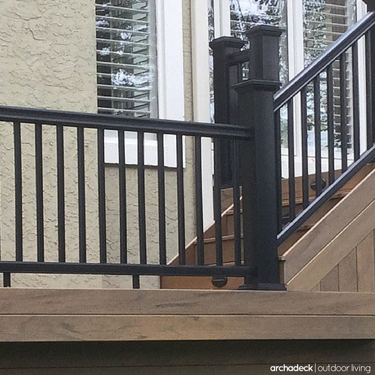 Black rails and sleek balusters complement modern, low maintenance decking | Deck Baluster Ideas: How To Choose The Best Baluster Design For Your Deck