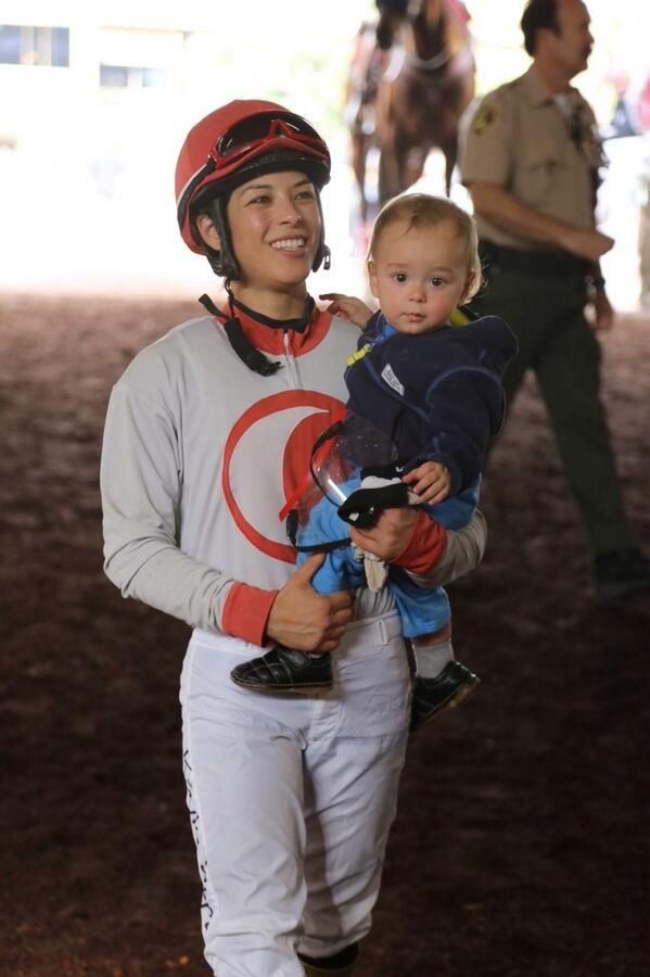Jockey Kayla Stra and her son Brys after a win at Santa Anita.